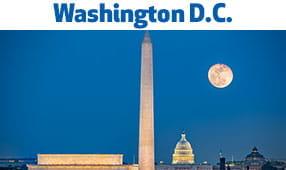 Washington D.C. - Washington Monument and capital buildings during twilight with full moon